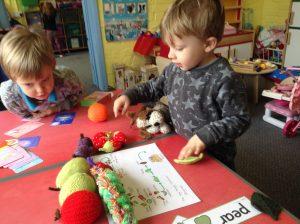 Happy preschool children learning about caterpillars