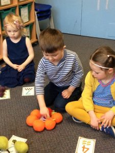 Counting fruit at Holy Apostles' Preschool
